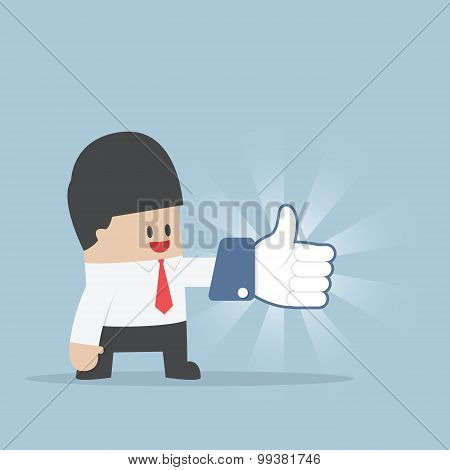 Businessman Wearing Thumbs Up Gloves