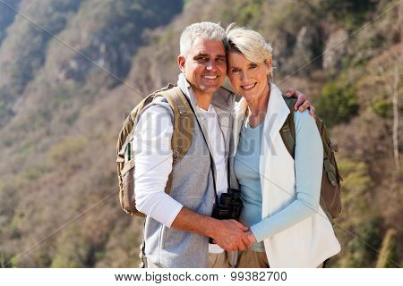 portrait of happy couple hiking in autumn mountain