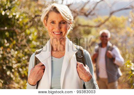 beautiful senior woman hiking in the mountain with husband