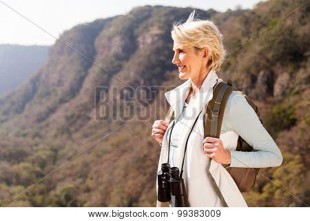 beautiful hiker enjoying the view from top of a mountain