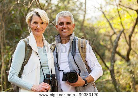 happy hikers couple enjoying outdoor activity