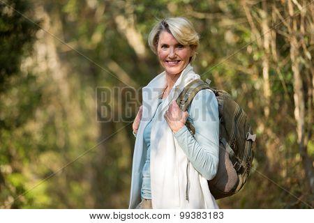 pretty senior woman mountain climbing