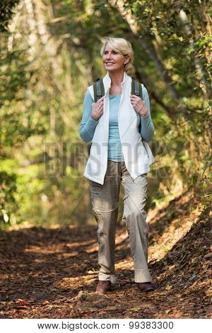 attractive middle aged woman hiking in mountain
