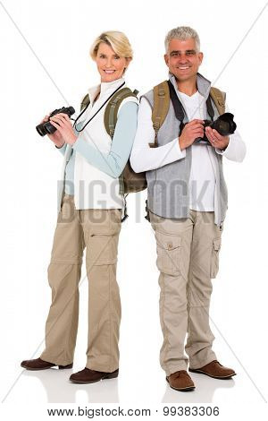 happy middle aged tourists standing on white background