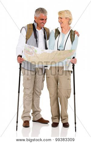 cheerful middle aged couple checking directions on a map isolated on white background