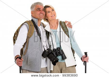 cute mid age hiking couple looking up on white background