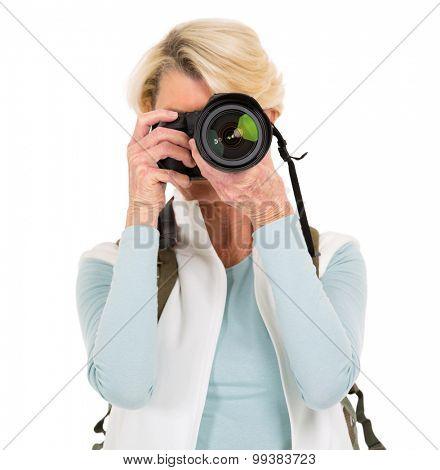senior woman taking photos isolated on white background