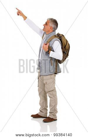 handsome mid age tourist pointing copy space on white background