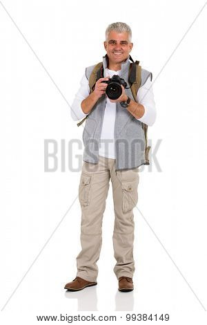 smiling mid age male hiker holding digital camera isolated on white