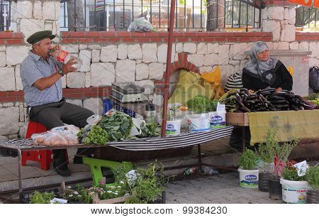 A turkish couple selling fresh food produce