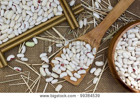Wooden Spoon With Cannellini Beans On Burlap