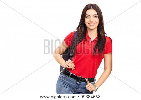 Young woman carrying a backpack and posing isolated on white background