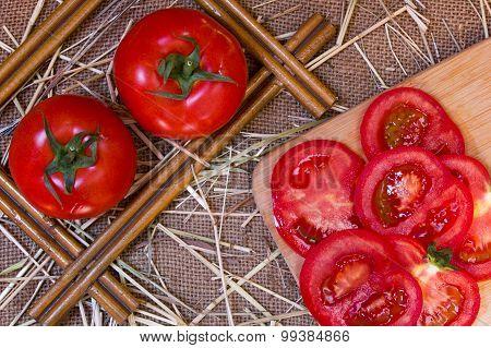 Tomatoes On Jute Sackcloth Background