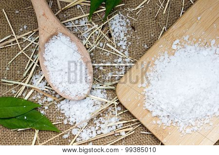 Sea Salt In Wooden Spoon On Burlap Sack Background