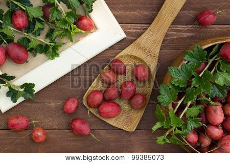 Ripe Gooseberries In A Wooden Spoon On The Table