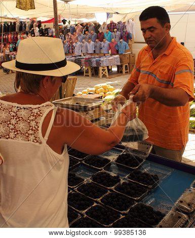 An english lady buying fresh blackberries