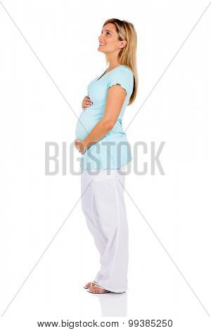 side view of pregnant woman looking up isolated on white