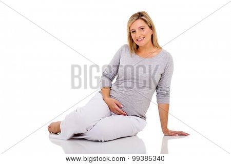 pretty pregnant woman sitting on the floor isolated