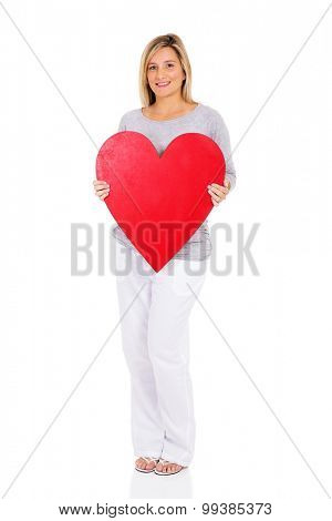 smiling young pregnant woman holding heart shape on white background