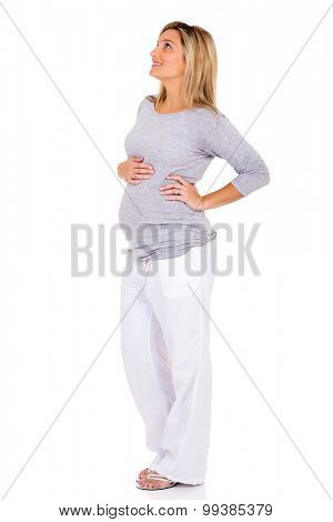 happy pregnant woman looking up on white background