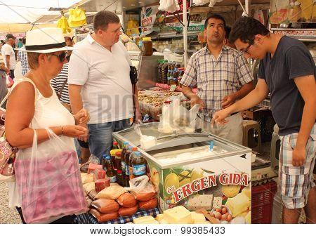 An English tourist buying fresh yogurt and cheese