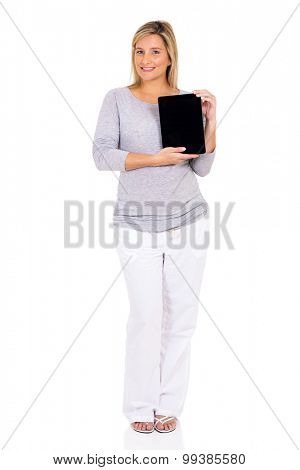 happy pregnant woman presenting tablet computer