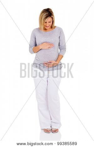 cute pregnant woman touching her belly on white background