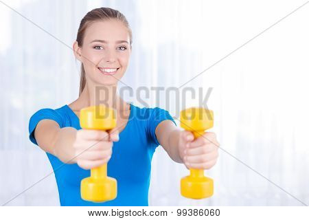 Happy girl doing exercises