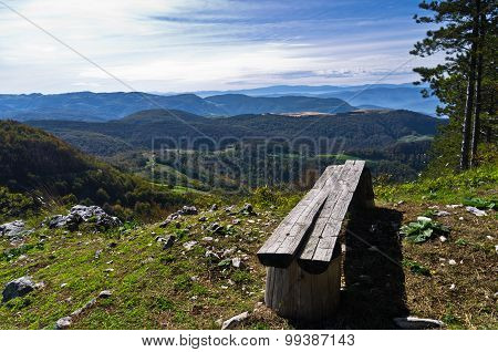 Viewpoint with a bench at mount Bobija, beautiful view of surrounding peaks, hills and meadows