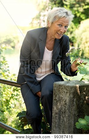 Business Woman Relaxing In The Nature