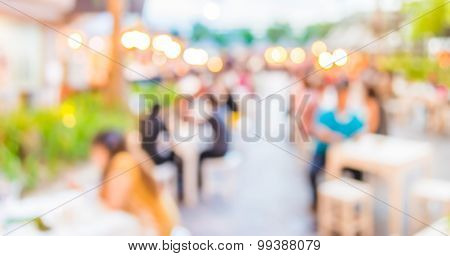 Blur Image Of People Dinner At Outdoor Festival   In Park