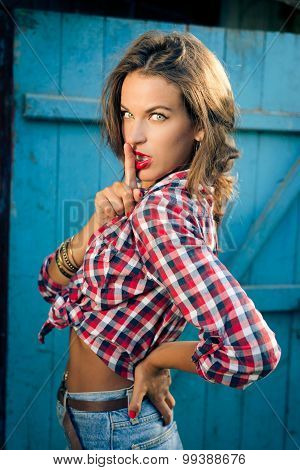 Vintage tanned young sensual hipster lady with finger on lips