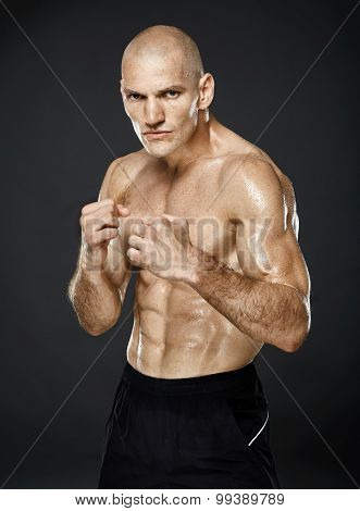 Kickboxer In Guard Stance On Gray Background