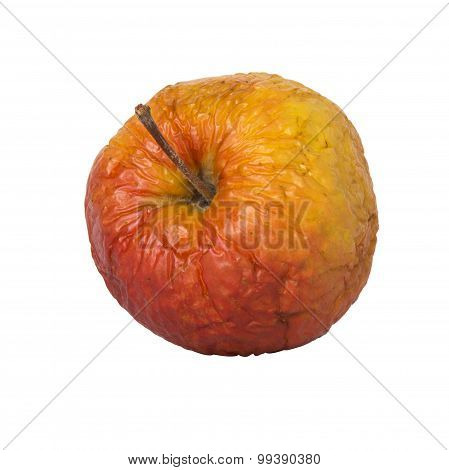 Old wrinkled apple, isolated on white.