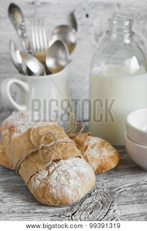 Homemade Rustic Bread On A Light Wooden Surface
