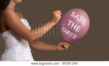 Bride Lets A Balloon With Text Burst With A Needle