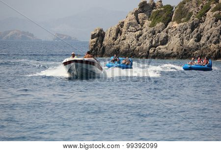 Tourists having fun riding in inflatables