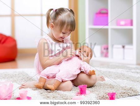 Cheerful little girl play in preschool