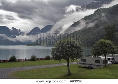 Camping By The Mountain Lake With Mountains And Glacier At Backg