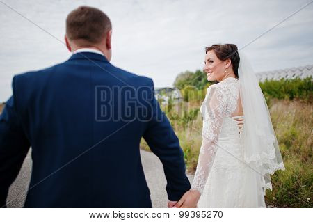 Holding Hands Wedding Couple