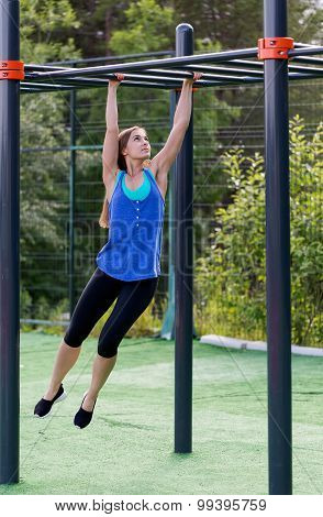 Woman In Sportswear On The Playground