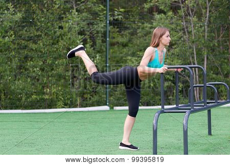 Beautiful Girl In Sportswear On The Playground Doing Fitness.