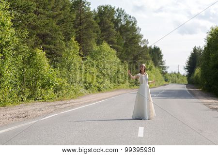 Girl In Dress On The Road