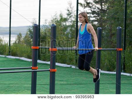 Girl In Sportswear Pushed On Bars