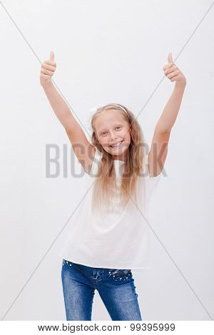 Portrait of a beautiful girl showing thumbs up on white