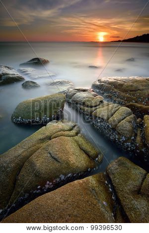 Misty Seascape At Sunset With Long Exposure