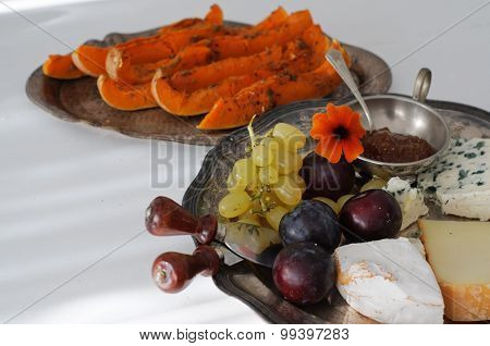Cheese Plate With Fall Fruits And Pumpkim