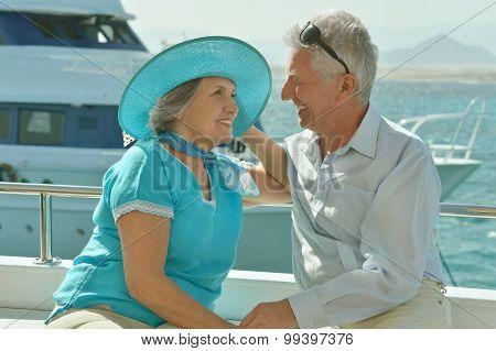 Elderly couple in boat on sea