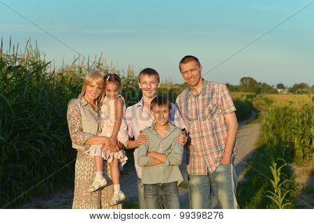 Family having rest in field