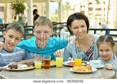 Mother and children  at breakfast